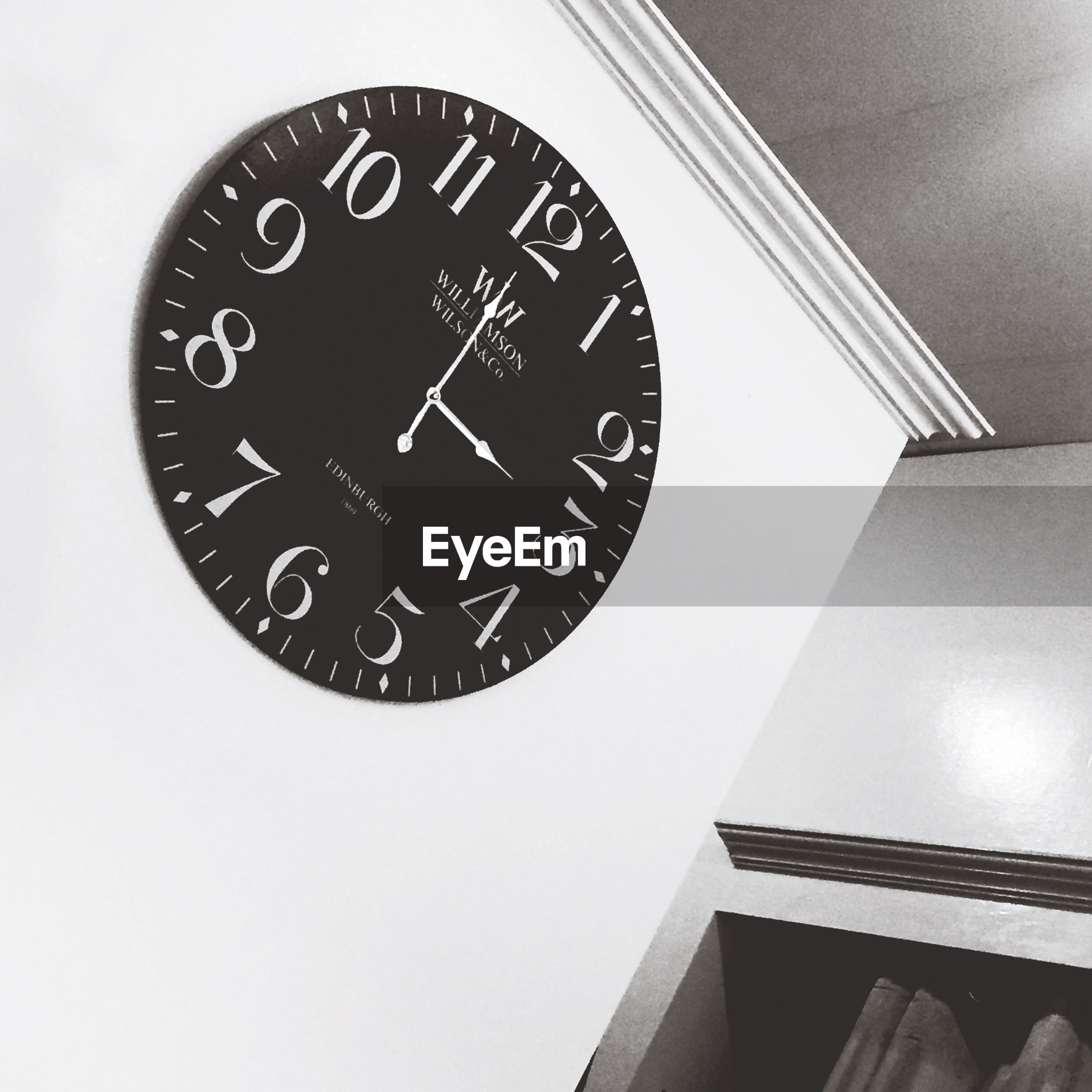 time, clock, number, communication, text, indoors, clock face, low angle view, close-up, minute hand, western script, wall clock, wall - building feature, roman numeral, instrument of time, accuracy, old-fashioned, circle, technology, no people