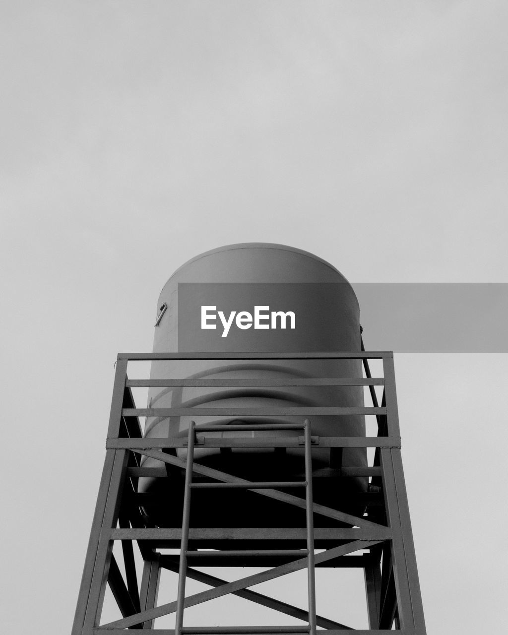 LOW ANGLE VIEW OF WATER TOWER AGAINST SKY AT FACTORY