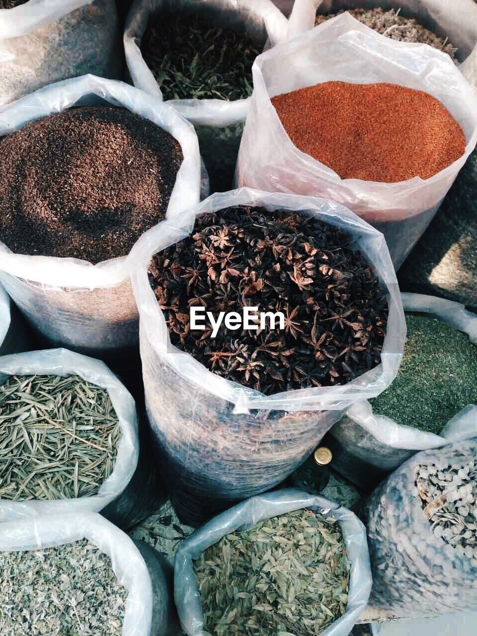 food and drink, spice, choice, variation, no people, food, high angle view, market, for sale, container, freshness, plant, day, still life, close-up, large group of objects, market stall, indoors, retail, nature, herb
