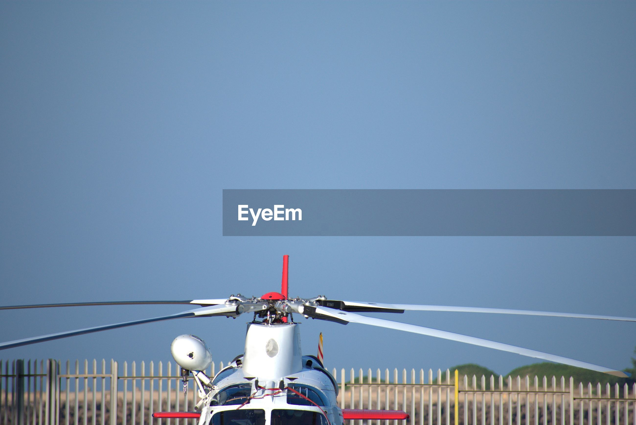 Helicopter against clear blue sky