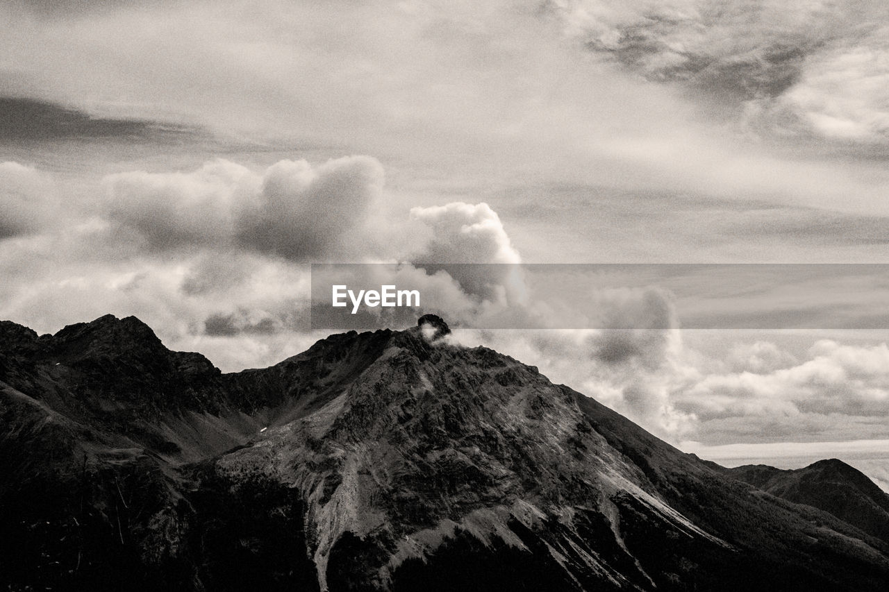 cloud - sky, sky, mountain, scenics - nature, beauty in nature, tranquil scene, tranquility, non-urban scene, environment, mountain range, nature, landscape, no people, day, mountain peak, low angle view, idyllic, remote, physical geography, outdoors, volcanic crater