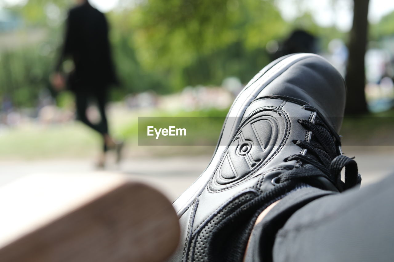 LOW SECTION OF PERSON WEARING SHOE