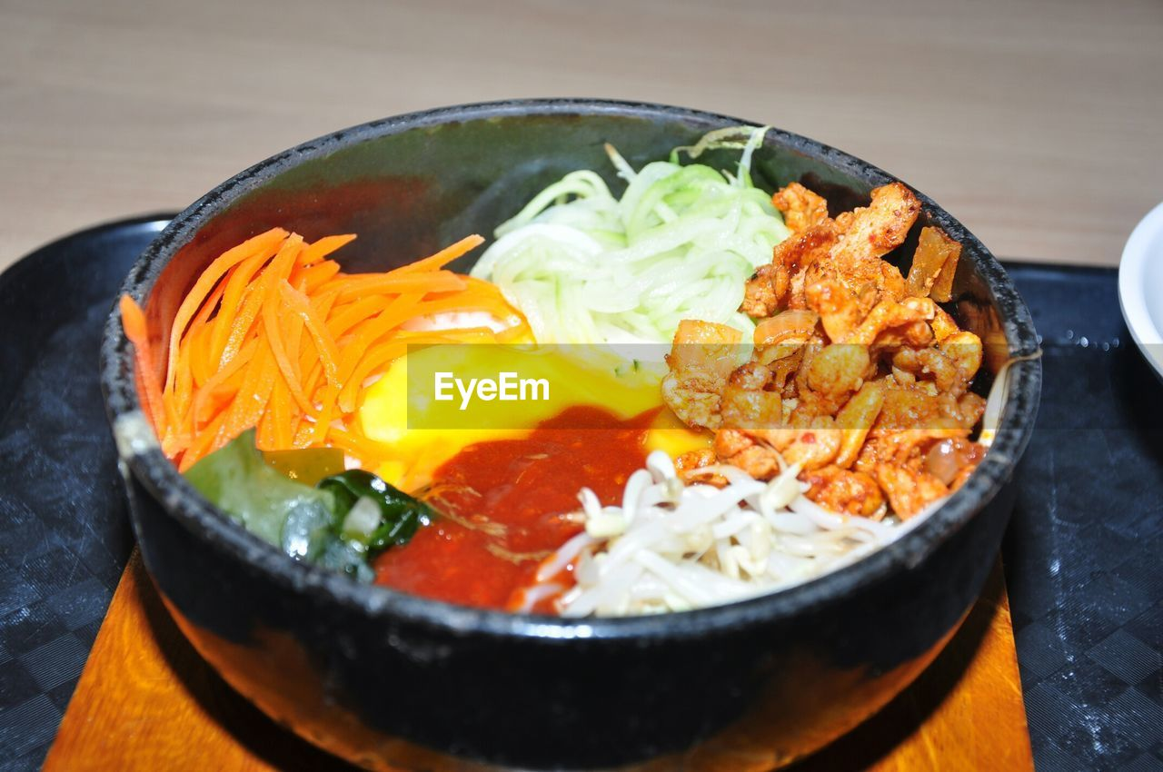 High Angle View Of Bibimbap Served In Bowl On Table