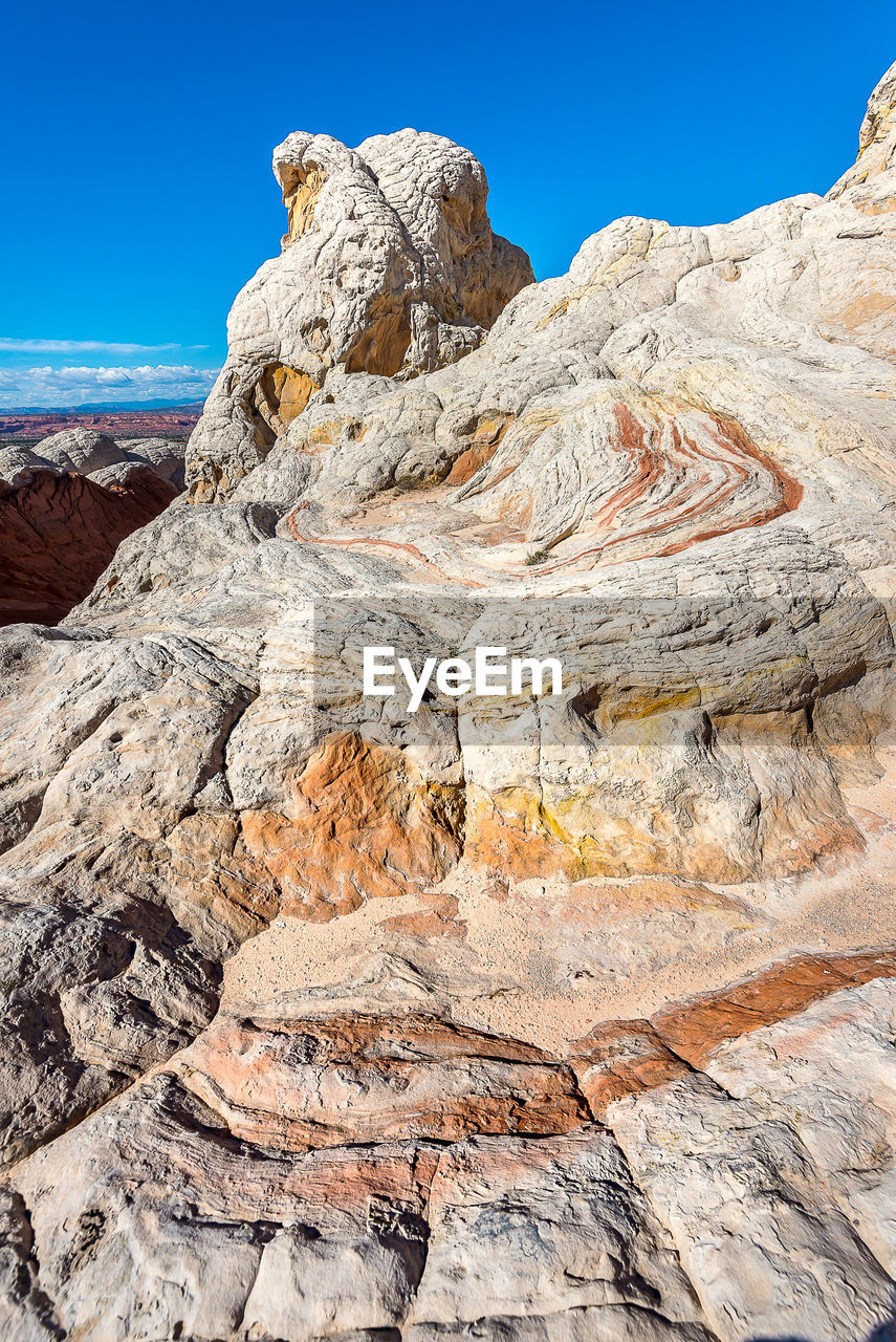 Scenic view of rock formation against blue sky