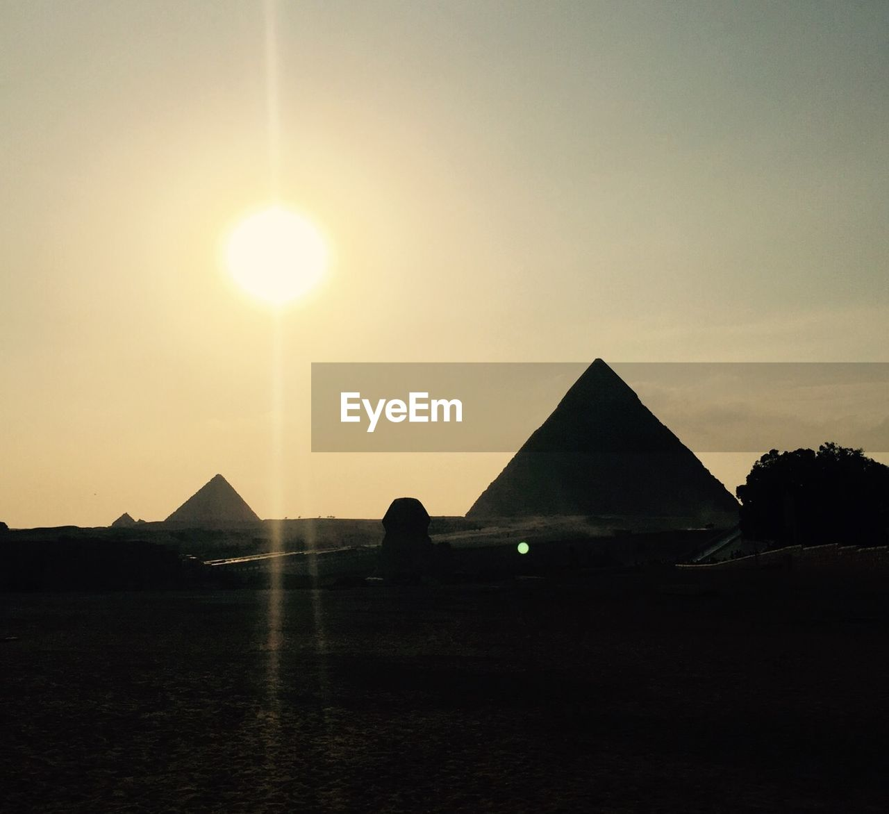 sun, pyramid, sunset, sky, sunlight, ancient, travel destinations, nature, silhouette, tranquil scene, history, architecture, tranquility, built structure, outdoors, ancient civilization, scenics, beauty in nature, landscape, building exterior, no people, clear sky, day, mammal