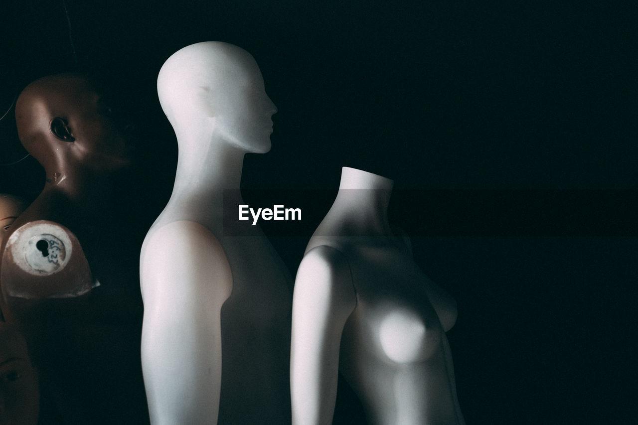 Female mannequins in darkroom