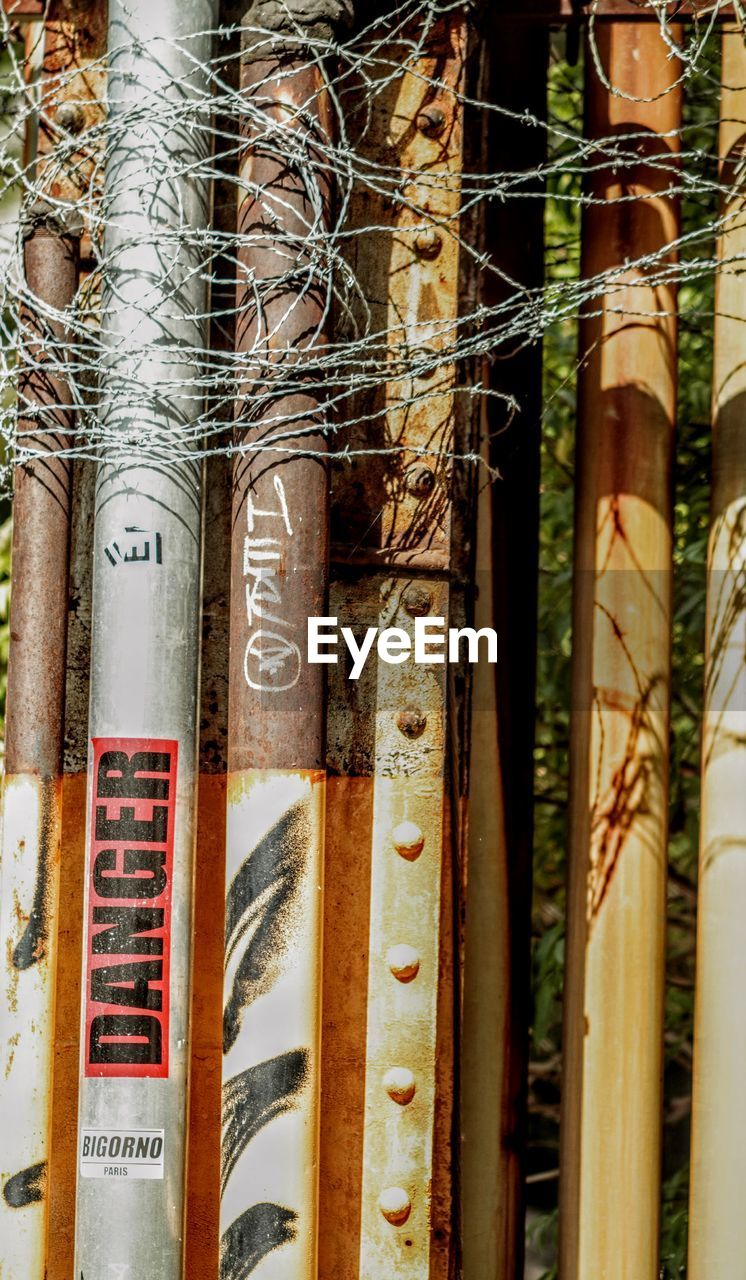 no people, text, communication, close-up, day, bamboo, focus on foreground, outdoors, number, bamboo - plant, sunlight, nature, script, plant, wood - material, non-western script, western script, full frame, backgrounds, brown