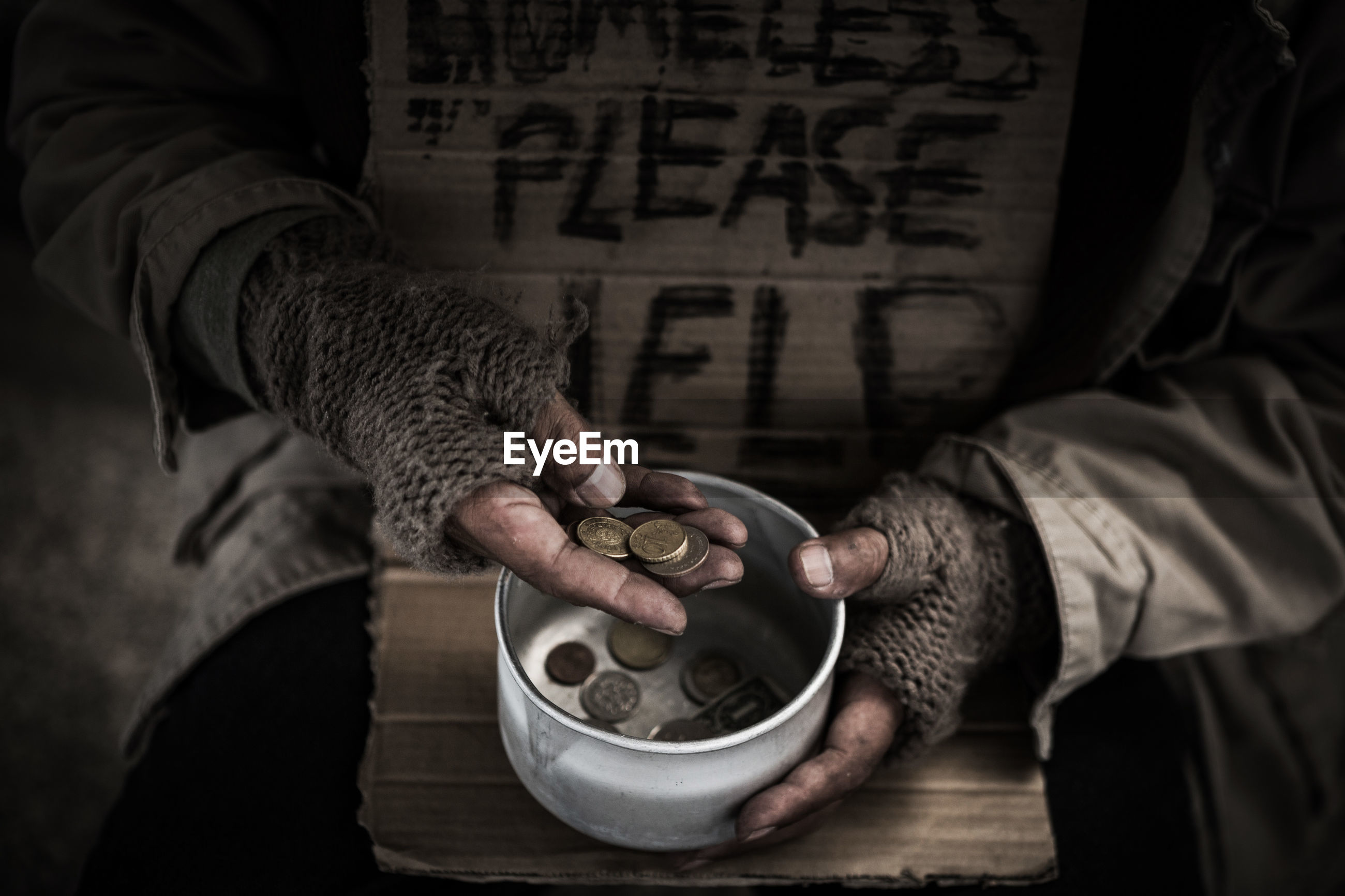 Midsection of beggar