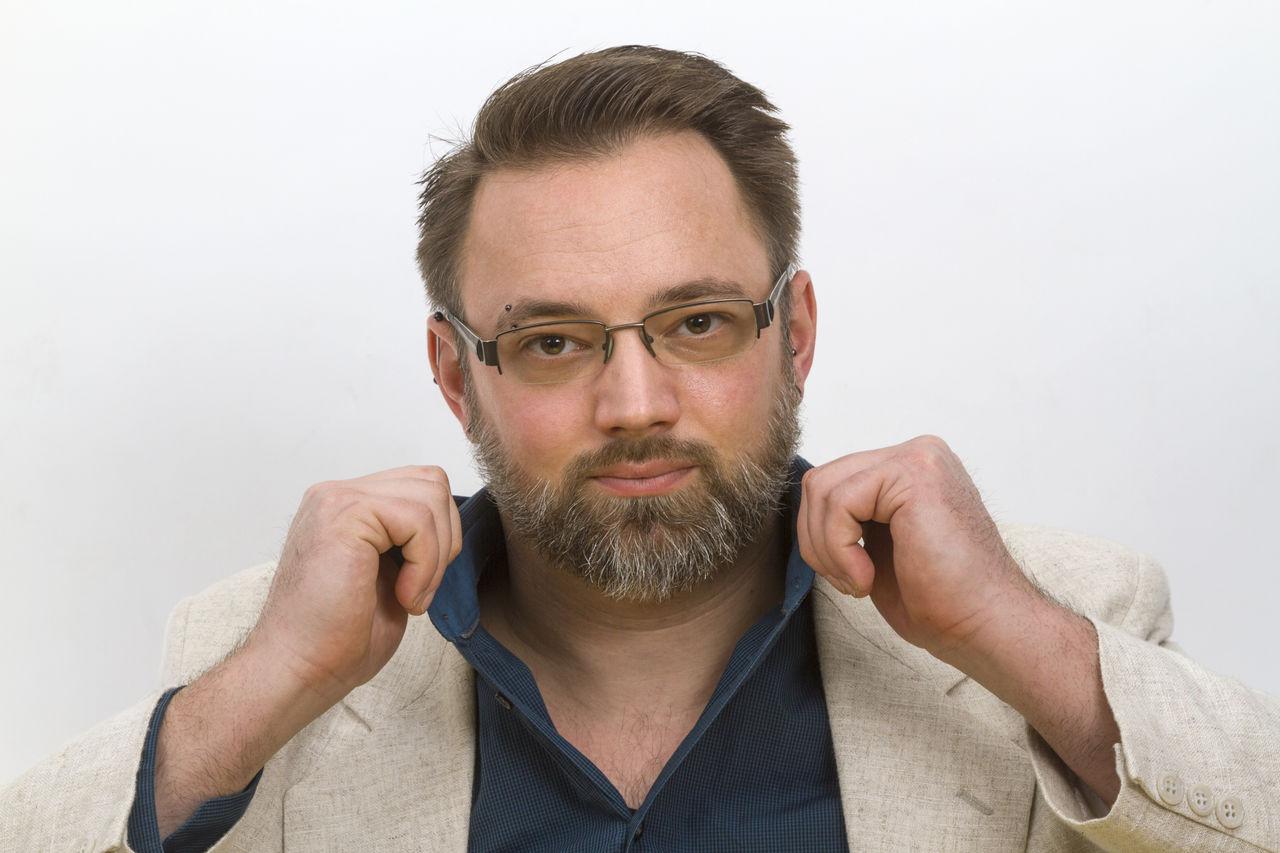 Portrait Of Mature Man Against White Background