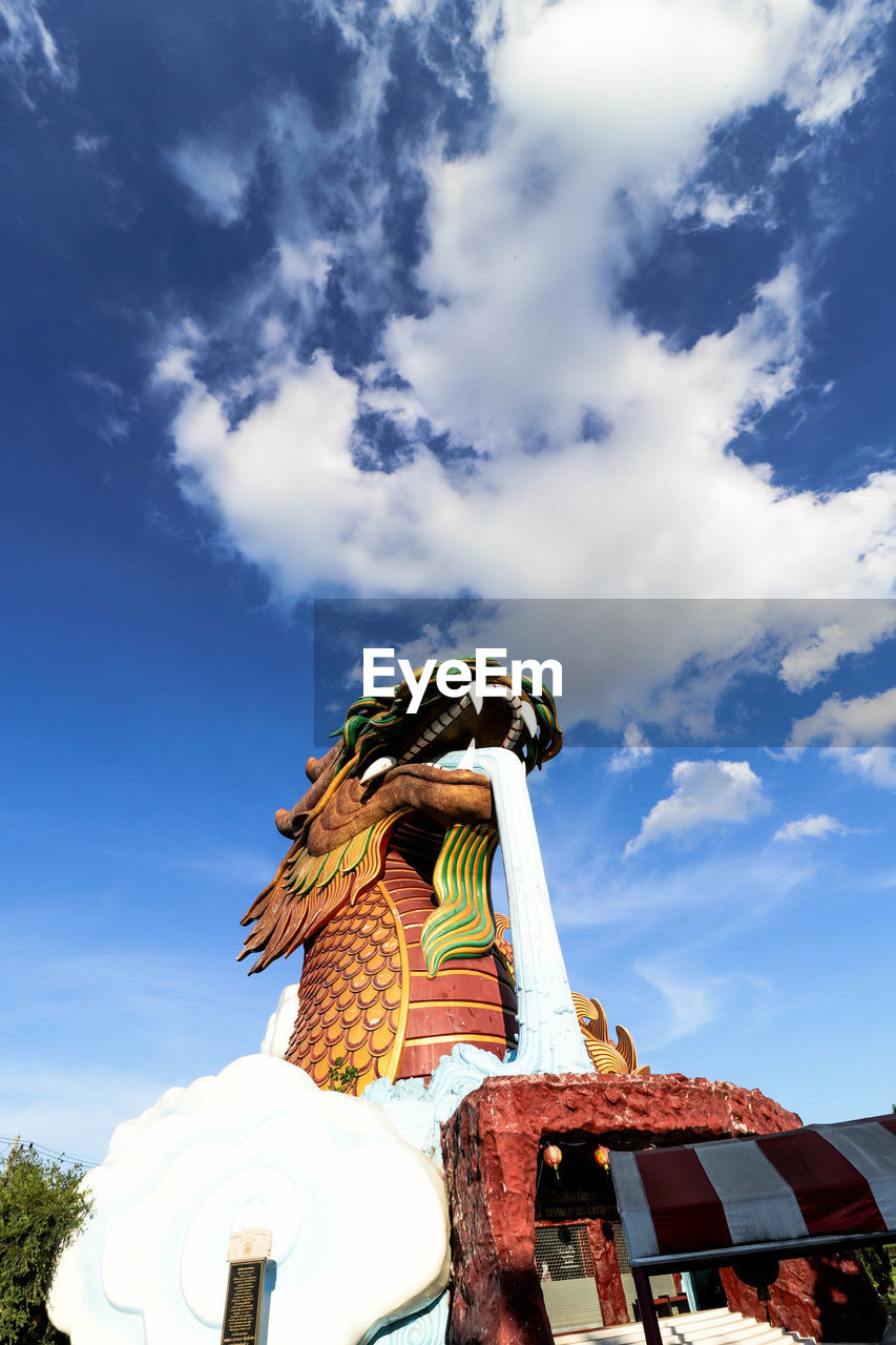 sky, cloud - sky, low angle view, representation, statue, human representation, art and craft, day, nature, sculpture, no people, creativity, craft, male likeness, outdoors, belief, architecture
