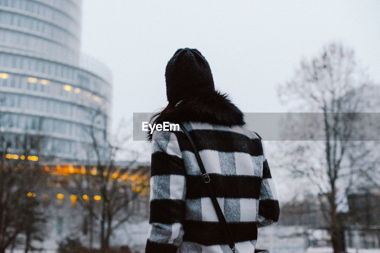 Rear View Of Woman Standing In City In Winter
