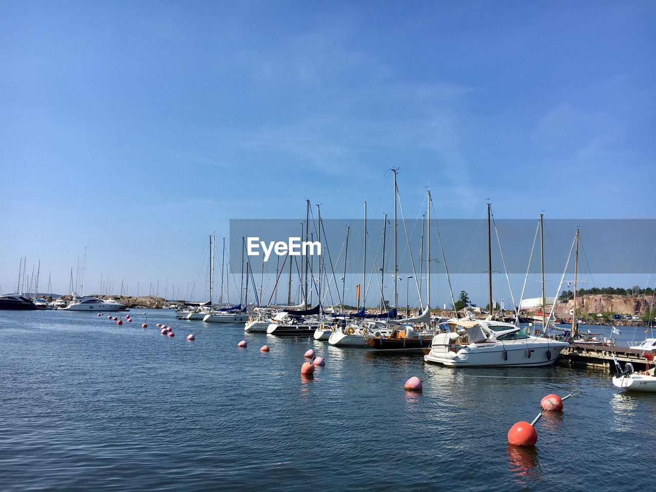 water, nautical vessel, transportation, sky, mode of transportation, sailboat, waterfront, sea, pole, mast, nature, harbor, day, blue, moored, beauty in nature, no people, scenics - nature, outdoors, yacht, marina