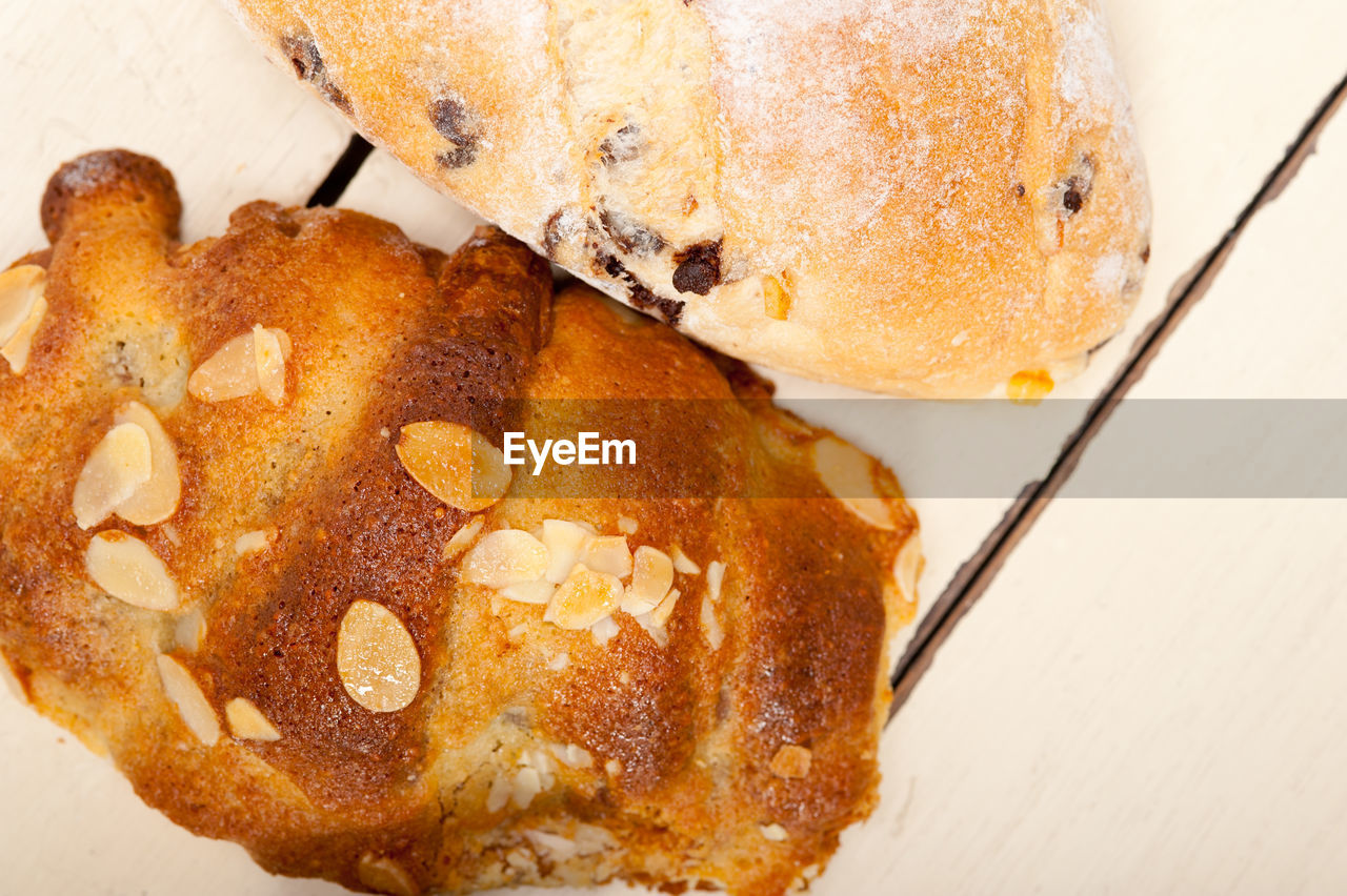 food, food and drink, close-up, still life, sweet food, freshness, ready-to-eat, baked, indulgence, indoors, high angle view, sweet, dessert, table, no people, temptation, kitchen utensil, bread, slice, eating utensil, snack