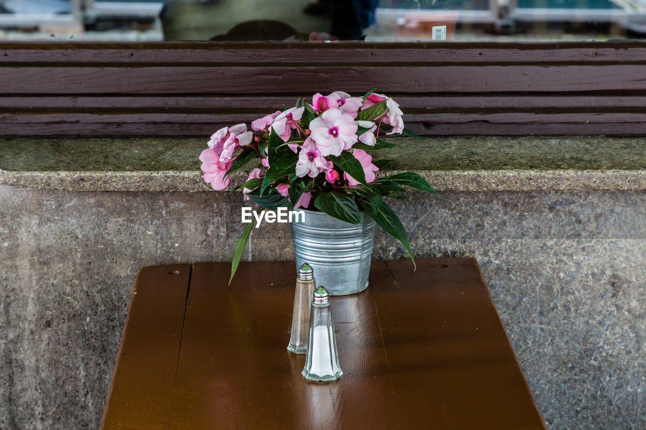 Flowers In Container On Table In Restaurant