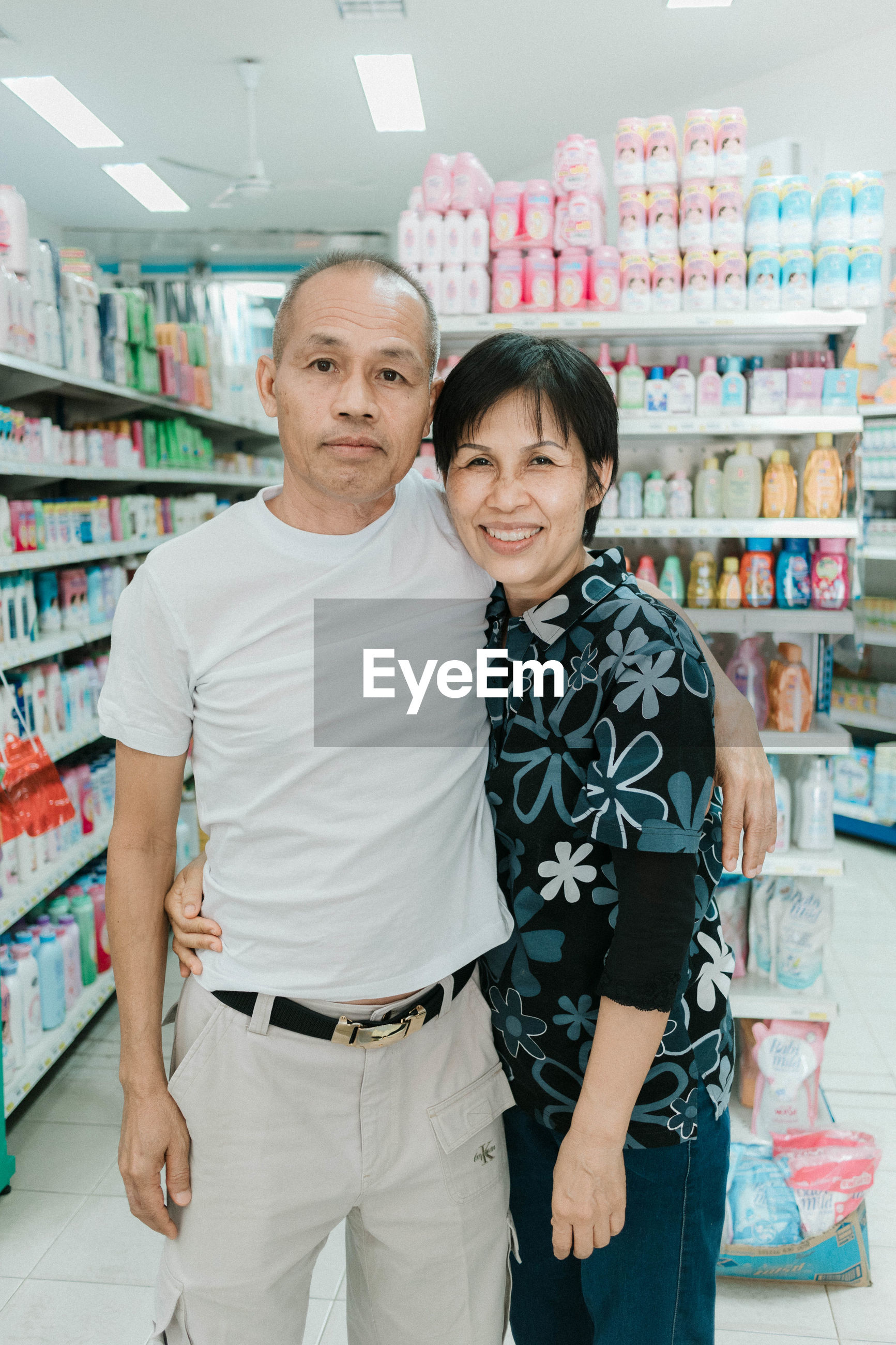Portrait of couple standing at supermarket