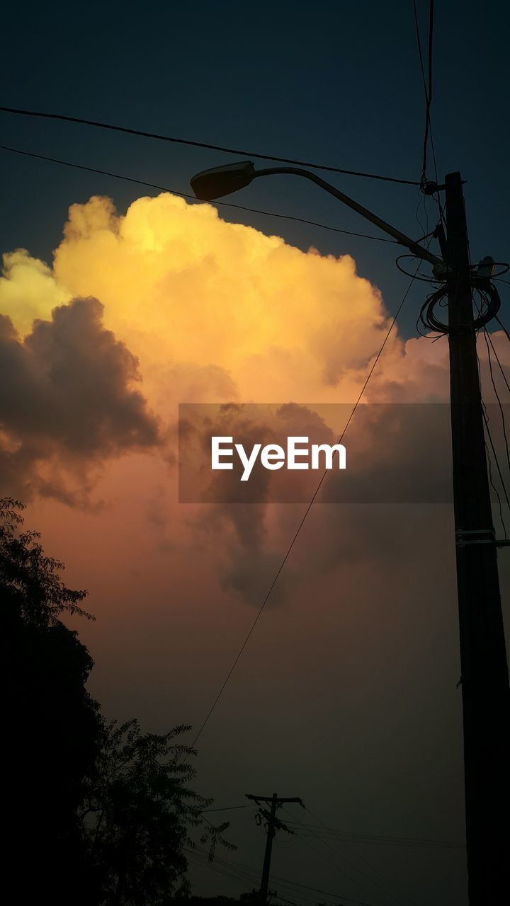cable, connection, power line, power supply, sky, electricity, low angle view, technology, sunset, fuel and power generation, cloud - sky, electricity pylon, no people, silhouette, outdoors, nature, telephone line, tree, beauty in nature, day