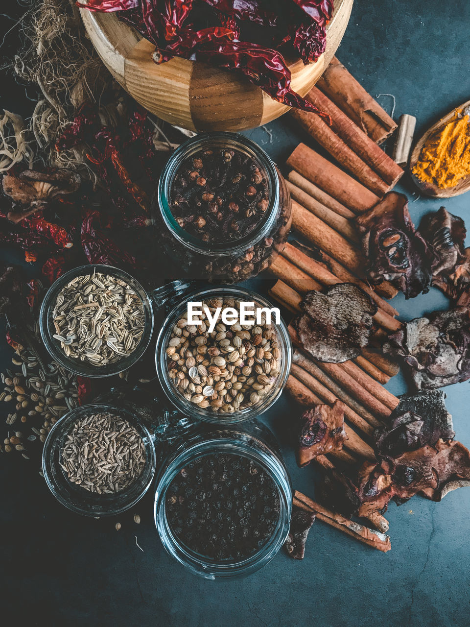 High angle view of spices and herbs on a black background