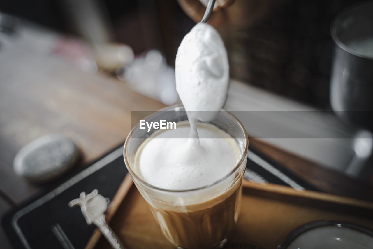 drink, food and drink, refreshment, coffee - drink, coffee, frothy drink, still life, table, indoors, cup, household equipment, freshness, coffee cup, close-up, glass, mug, pouring, focus on foreground, hot drink, latte, no people, preparation, froth, coffee shop, non-alcoholic beverage