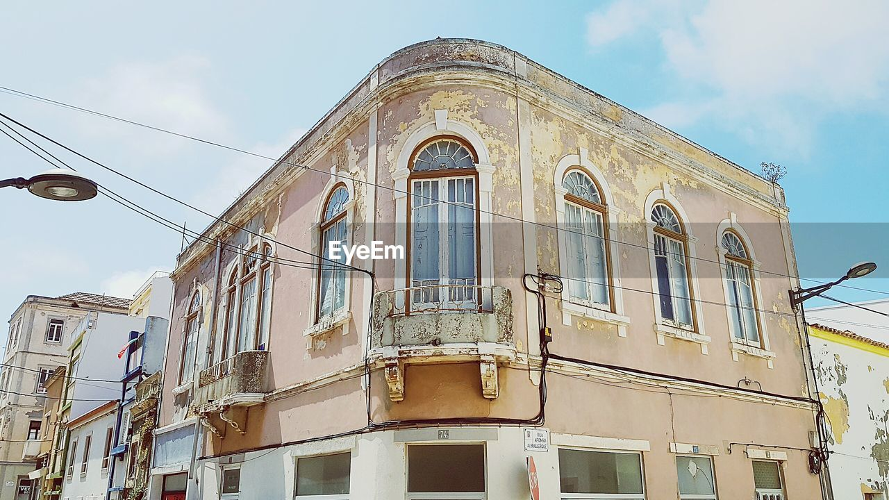 low angle view, architecture, built structure, building exterior, outdoors, day, no people, sky