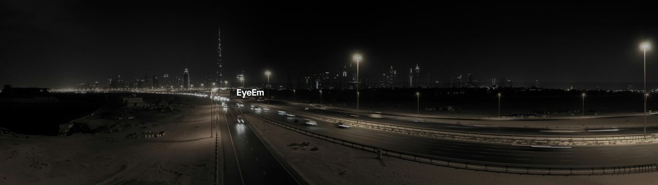 Panoramic view of roads against sky in city at night