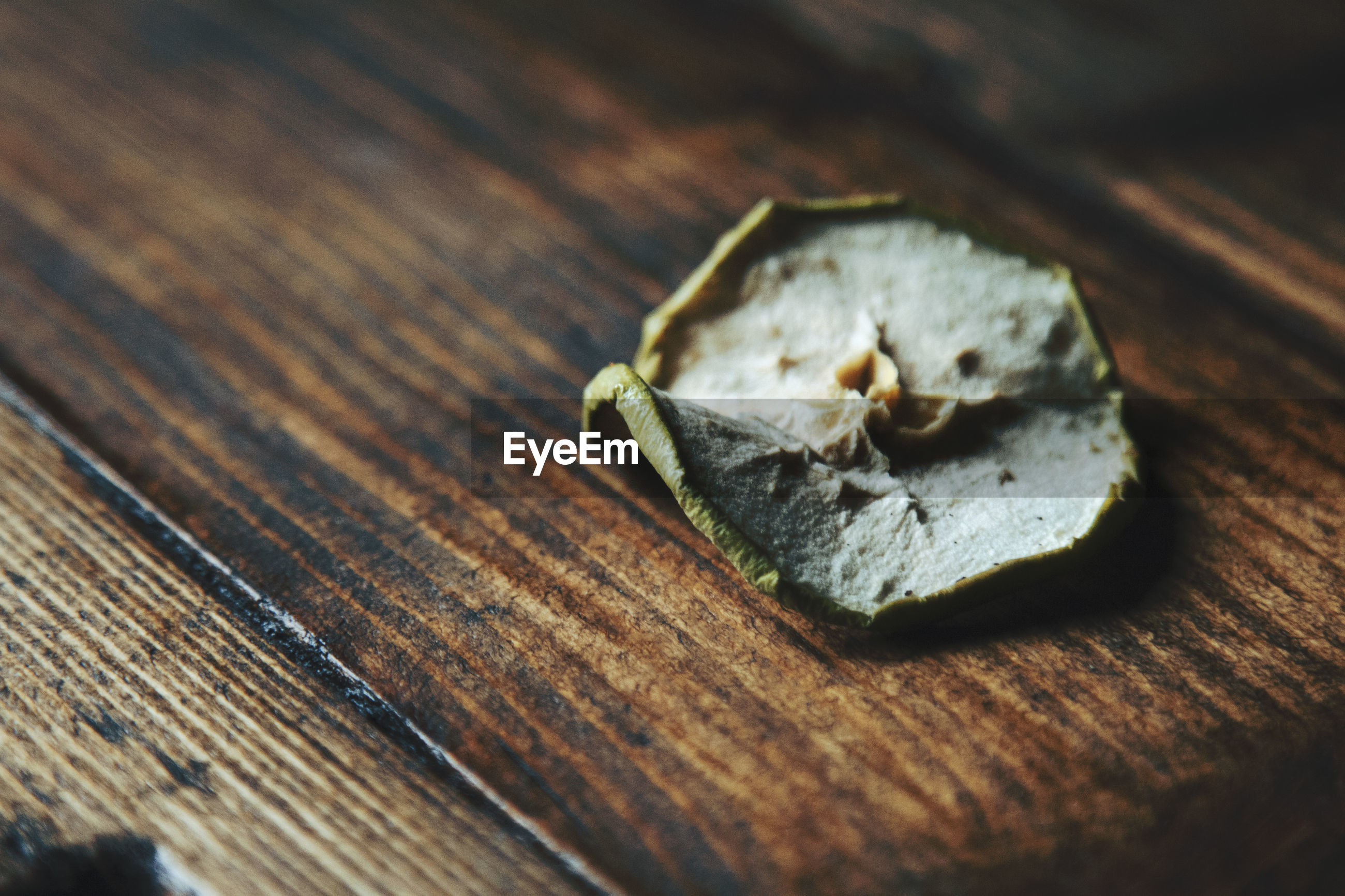 High angle view of dried apple slice on table