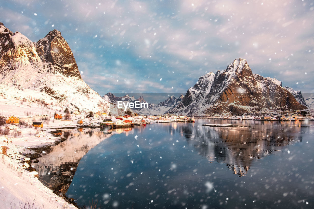 water, reflection, mountain, cold temperature, beauty in nature, winter, sky, scenics - nature, snow, cloud - sky, tranquility, lake, tranquil scene, nature, mountain range, environment, no people, waterfront, snowcapped mountain, formation