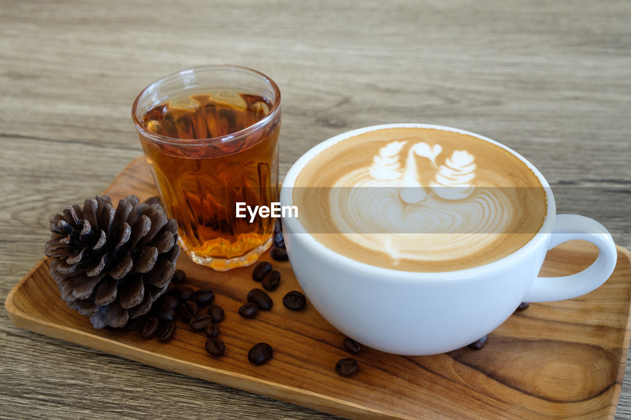 refreshment, drink, food and drink, cup, coffee - drink, coffee, still life, coffee cup, mug, table, freshness, hot drink, wood - material, frothy drink, cappuccino, food, glass, close-up, indoors, no people, latte, crockery, non-alcoholic beverage
