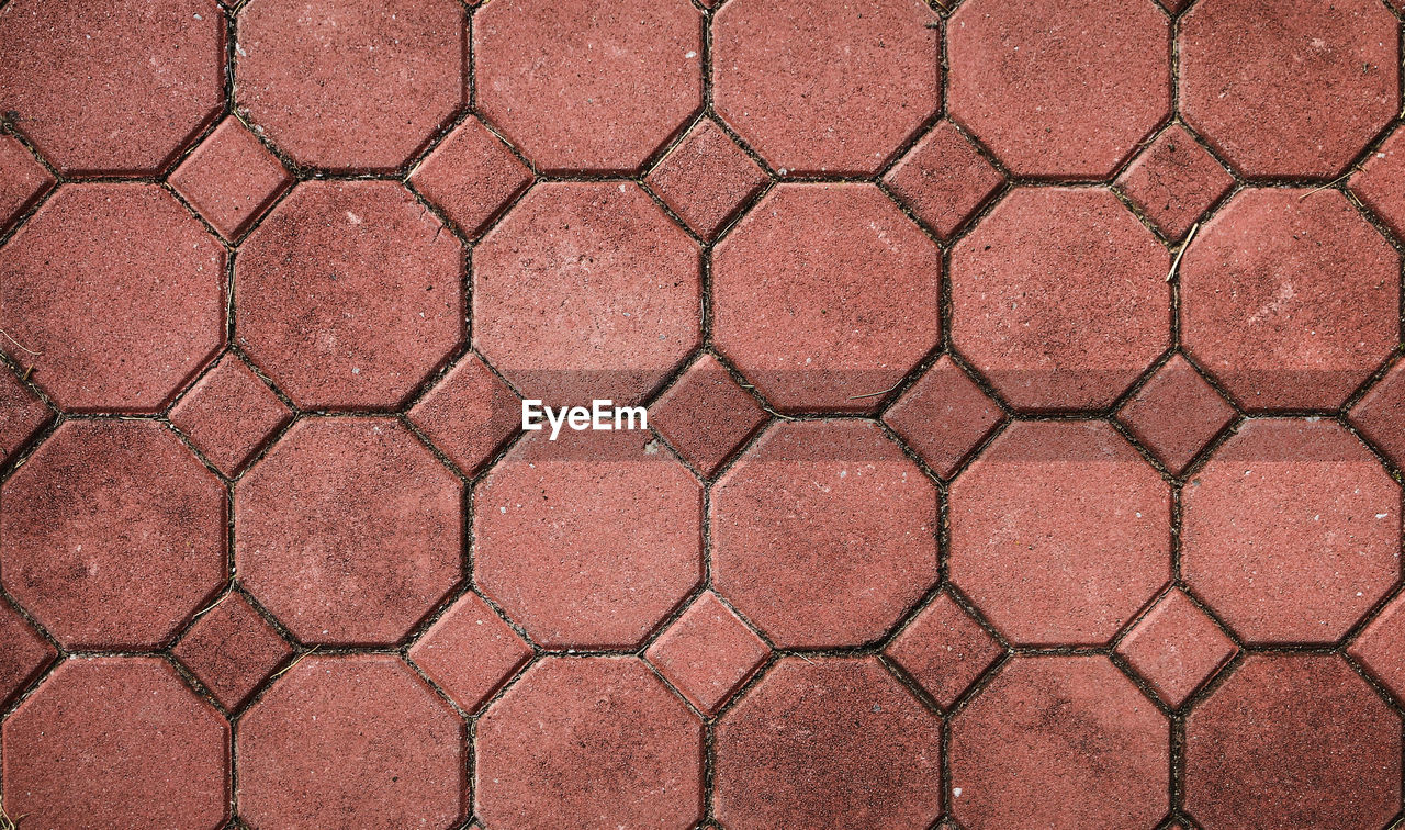full frame, backgrounds, pattern, geometric shape, no people, shape, day, textured, brown, outdoors, directly above, footpath, high angle view, hexagon, flooring, architecture, repetition, close-up, design, circle