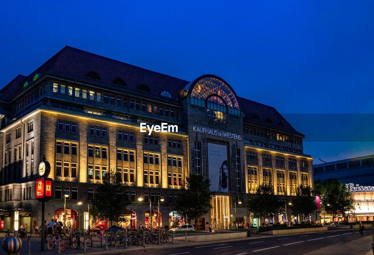 VIEW OF ILLUMINATED BUILDING AT NIGHT