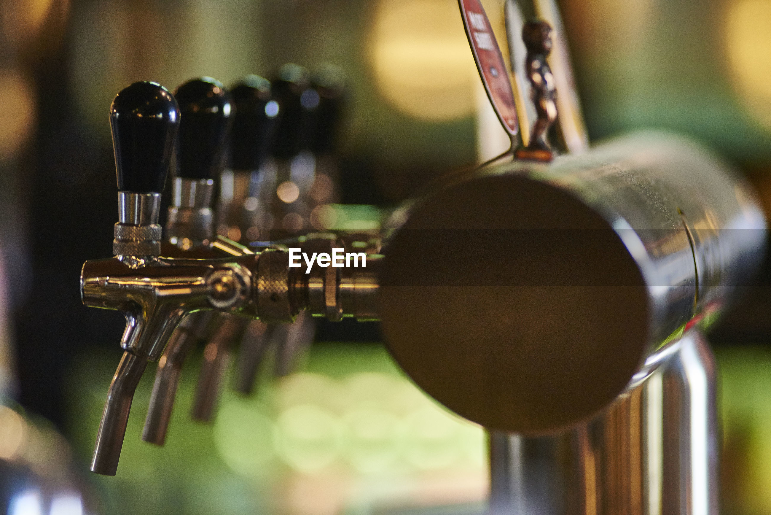 metal, indoors, close-up, focus on foreground, no people, beer tap, music, craft beer, brewery, musical instrument, day