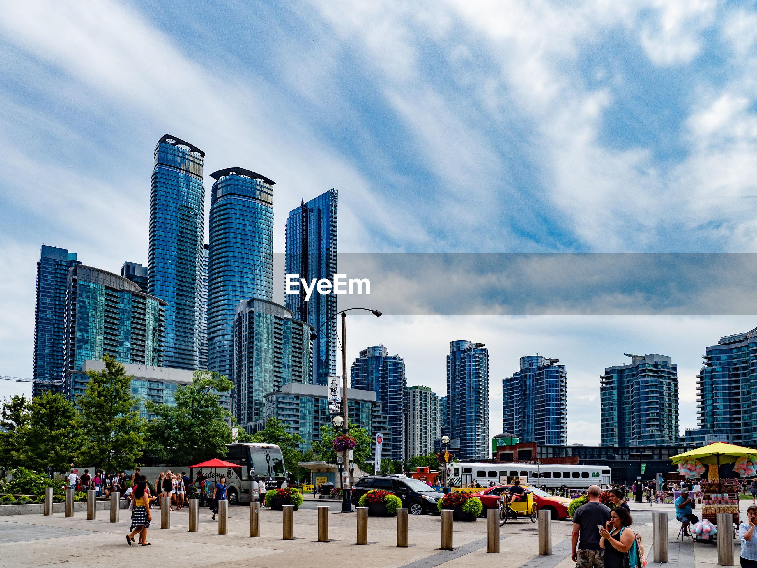 PEOPLE IN MODERN BUILDINGS AGAINST SKY