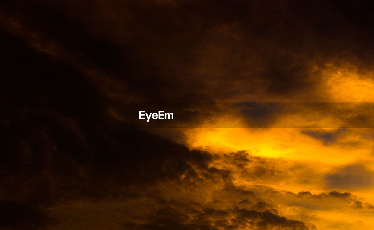 cloud - sky, sky, beauty in nature, orange color, scenics - nature, sunset, tranquility, idyllic, no people, nature, dramatic sky, tranquil scene, low angle view, cloudscape, outdoors, night, majestic, dark, overcast, meteorology, power in nature, ominous