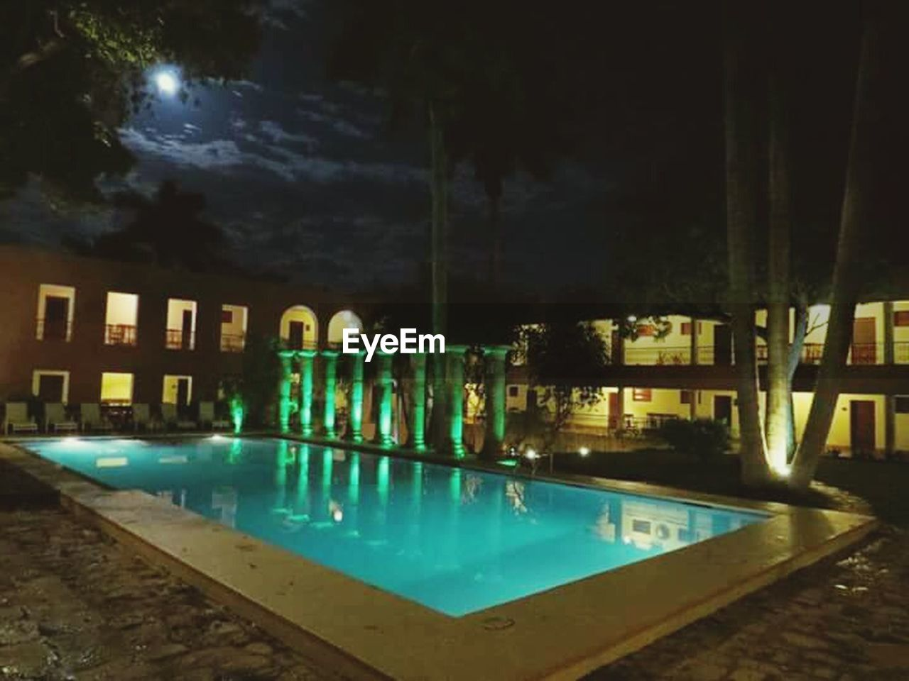 swimming pool, water, night, reflection, illuminated, no people, outdoors, architecture, luxury, sky, tree, nature