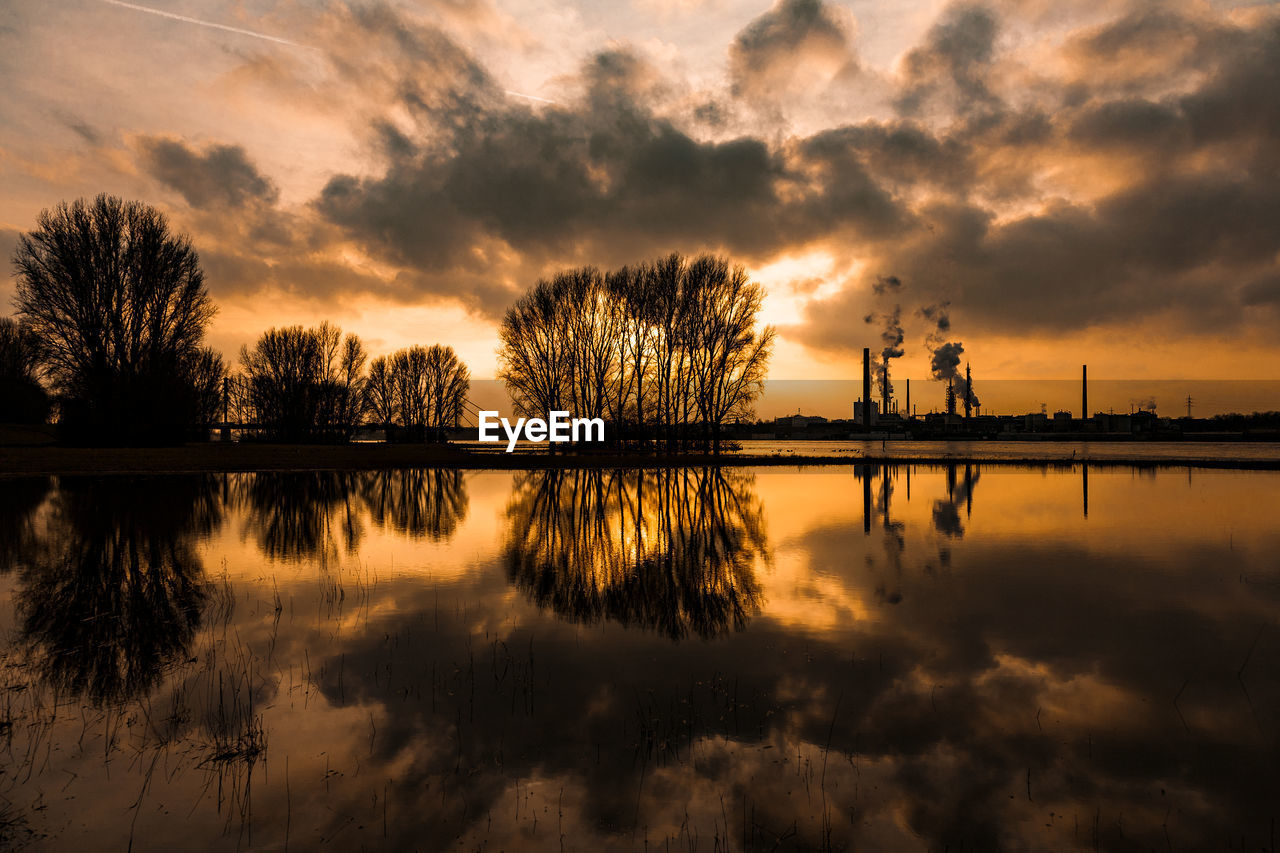 sky, reflection, cloud - sky, sunset, water, scenics - nature, tranquility, beauty in nature, tree, tranquil scene, waterfront, no people, lake, nature, silhouette, plant, orange color, idyllic, outdoors