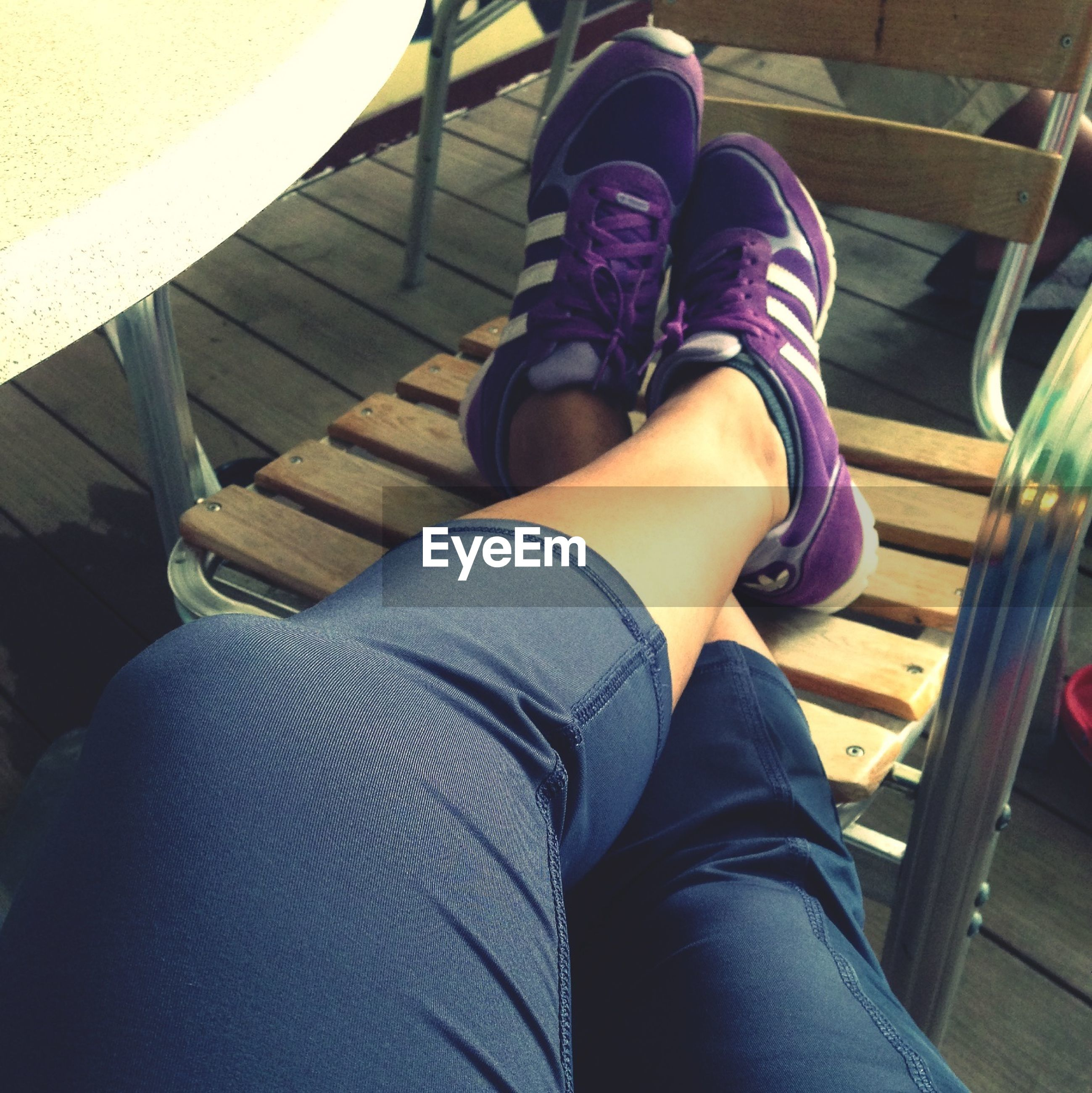 low section, person, shoe, jeans, indoors, personal perspective, lifestyles, human foot, standing, sitting, footwear, casual clothing, men, relaxation, high angle view, leisure activity, legs crossed at ankle