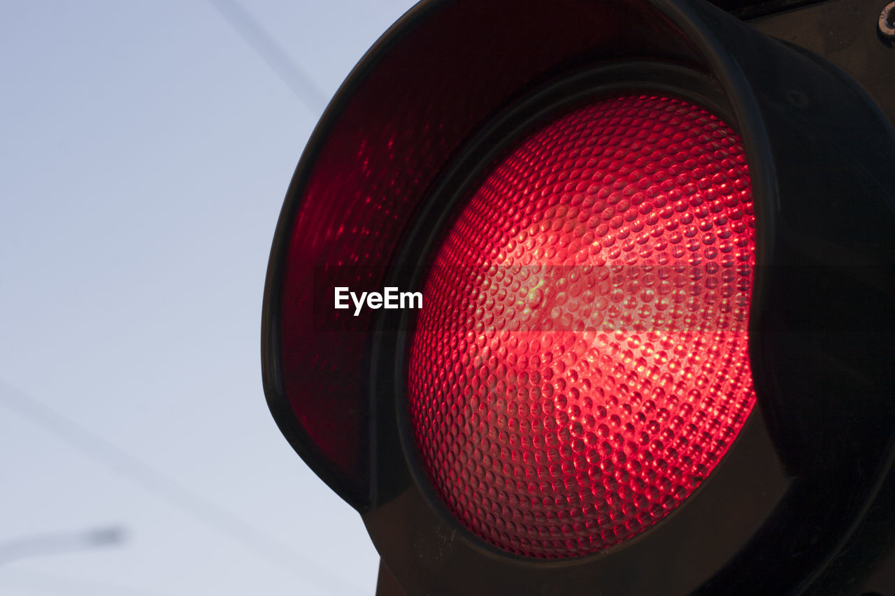 Low angle view of red traffic light