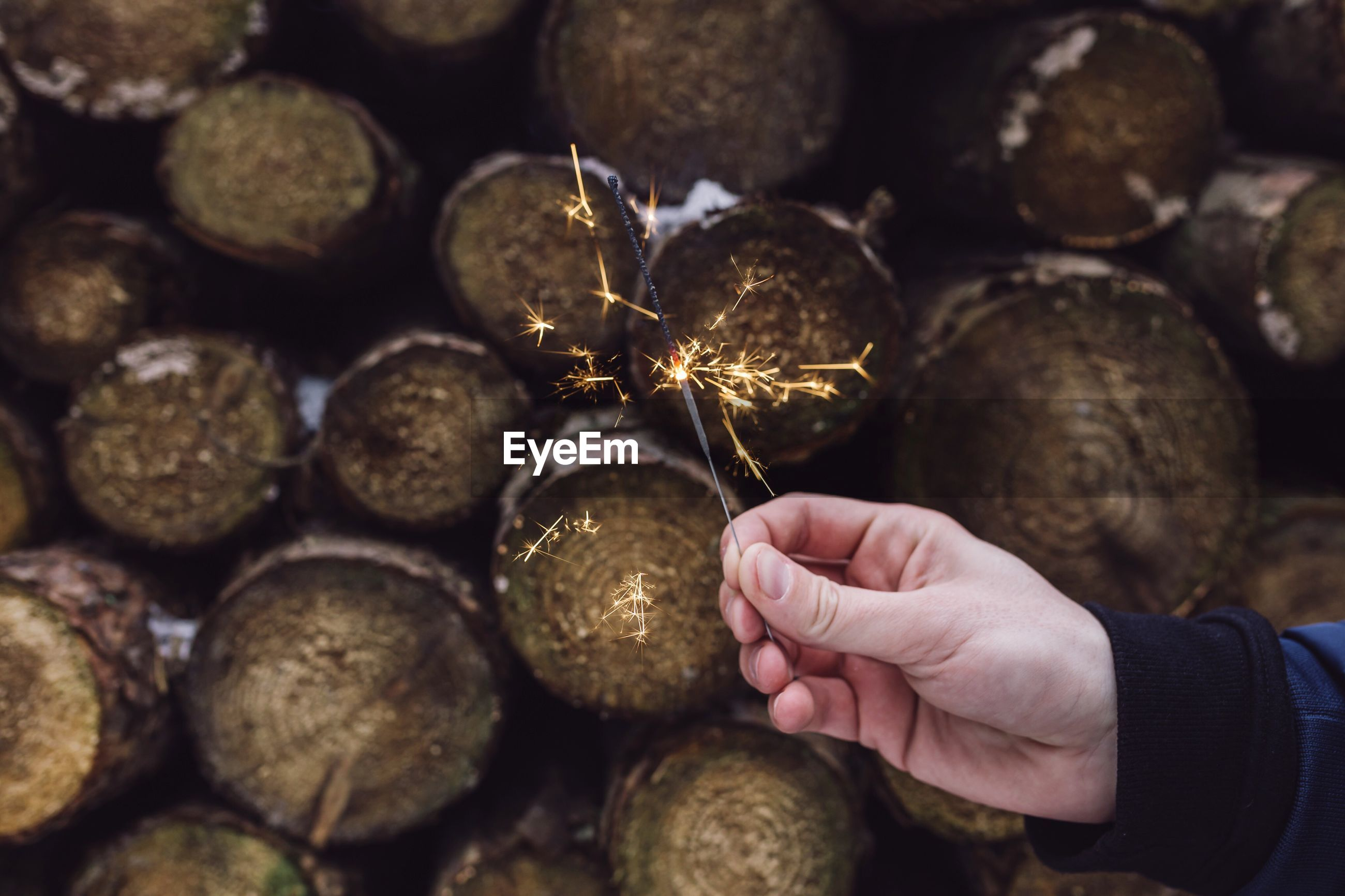 Close-up of hand holding sparkler