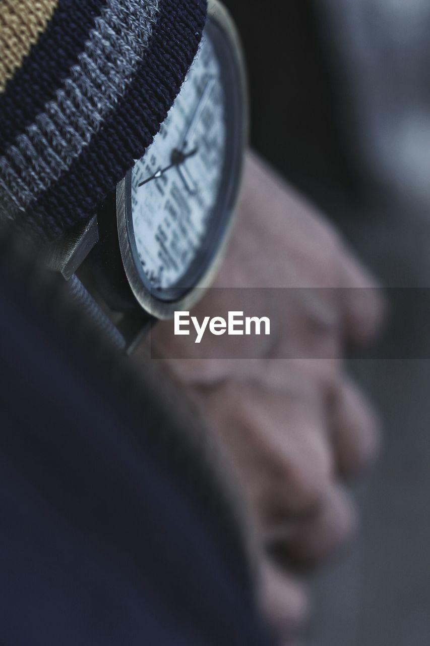 Close-Up Of Man Wearing Watch