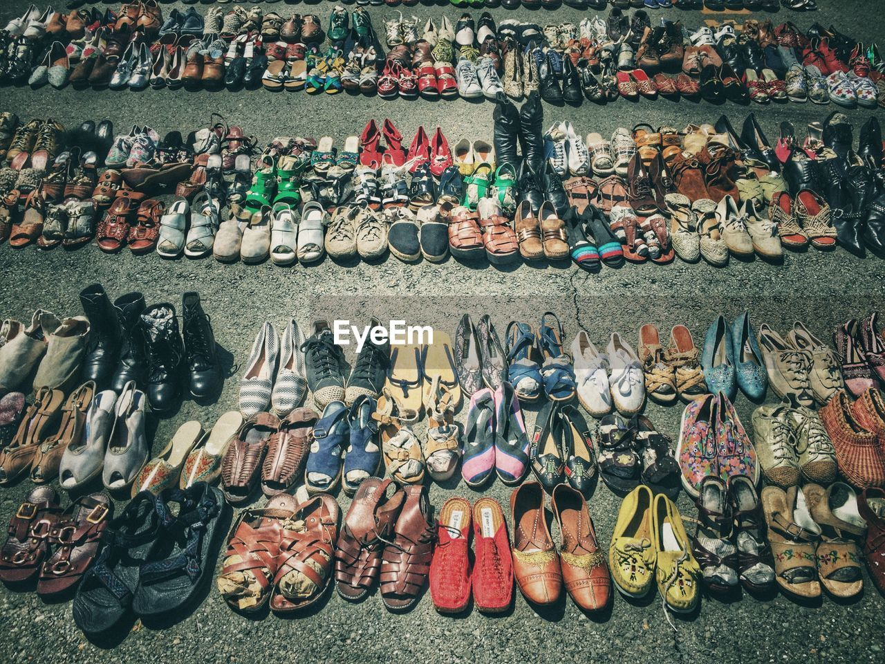 High angle view of footwear for sale at street market on sunny day