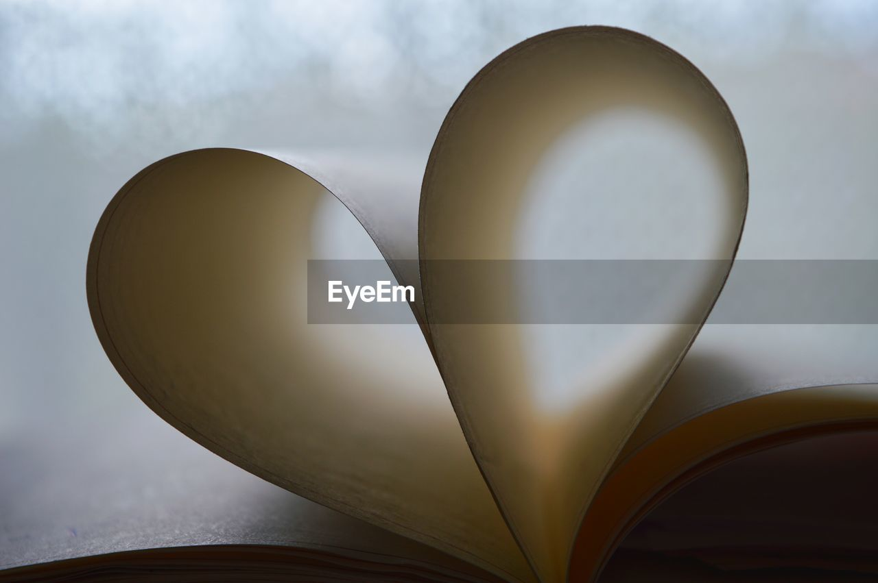 Heart shape made of papers in book