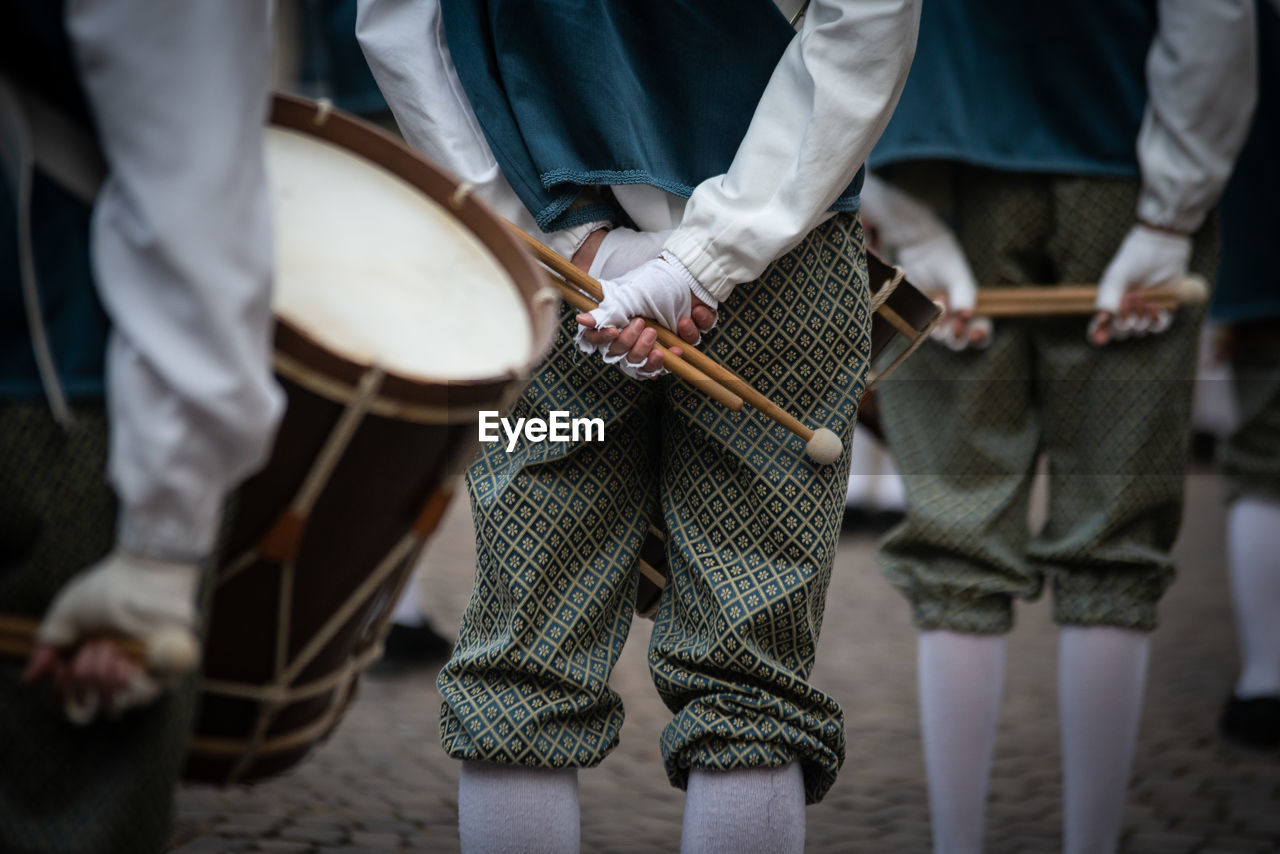 People in uniform with drums