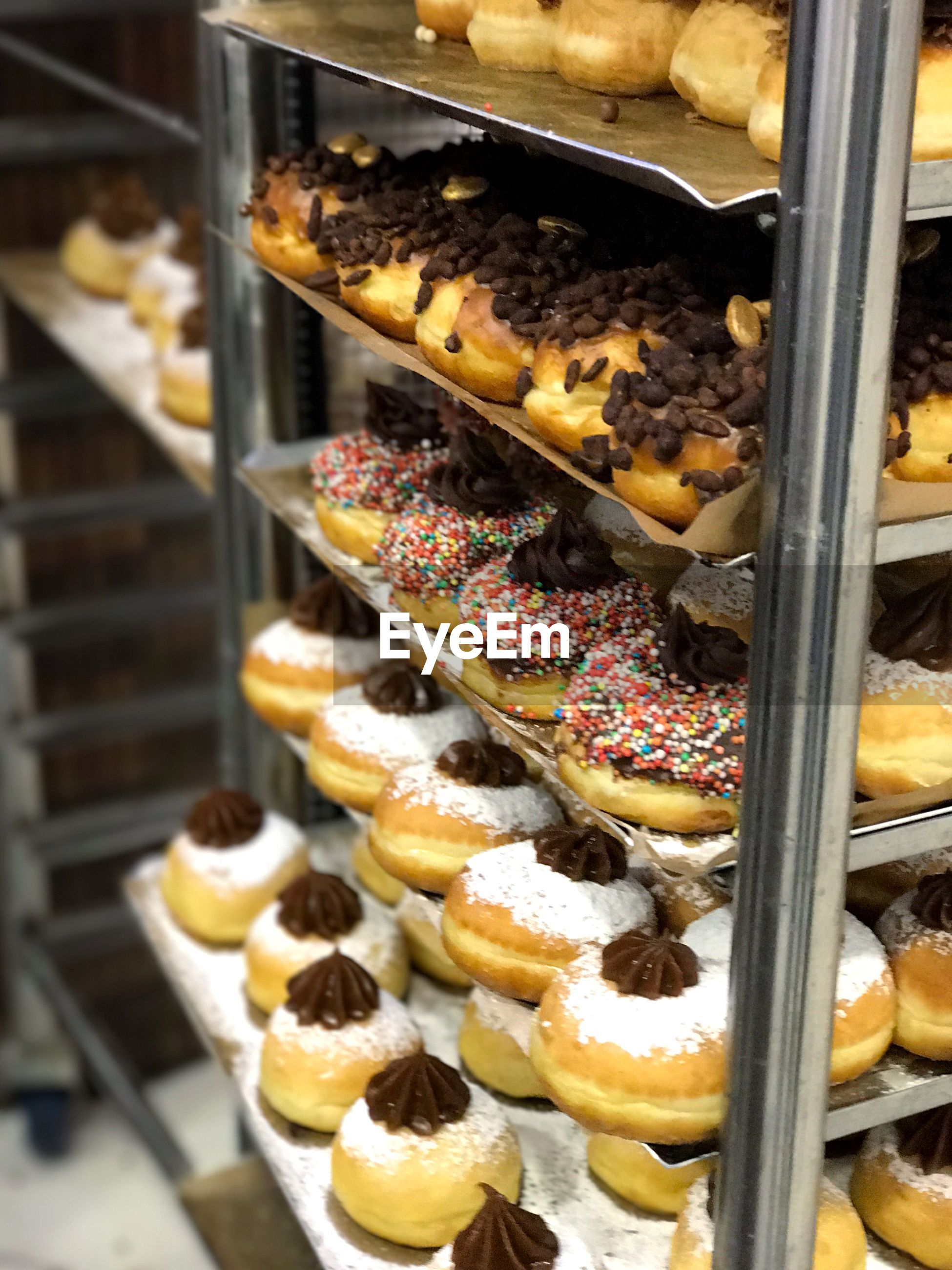 Close-up of donuts on rack at bakery