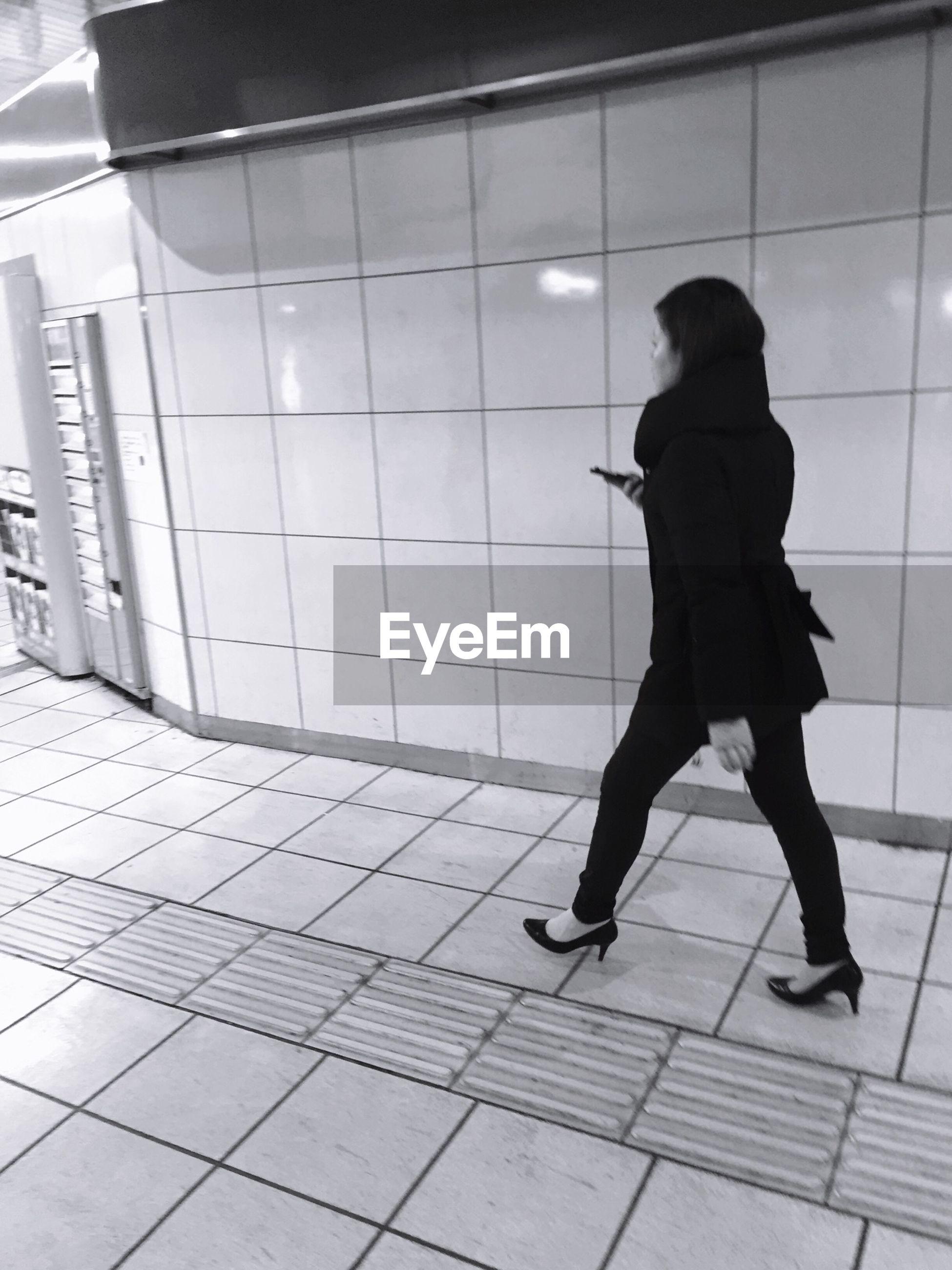 Woman walking in office