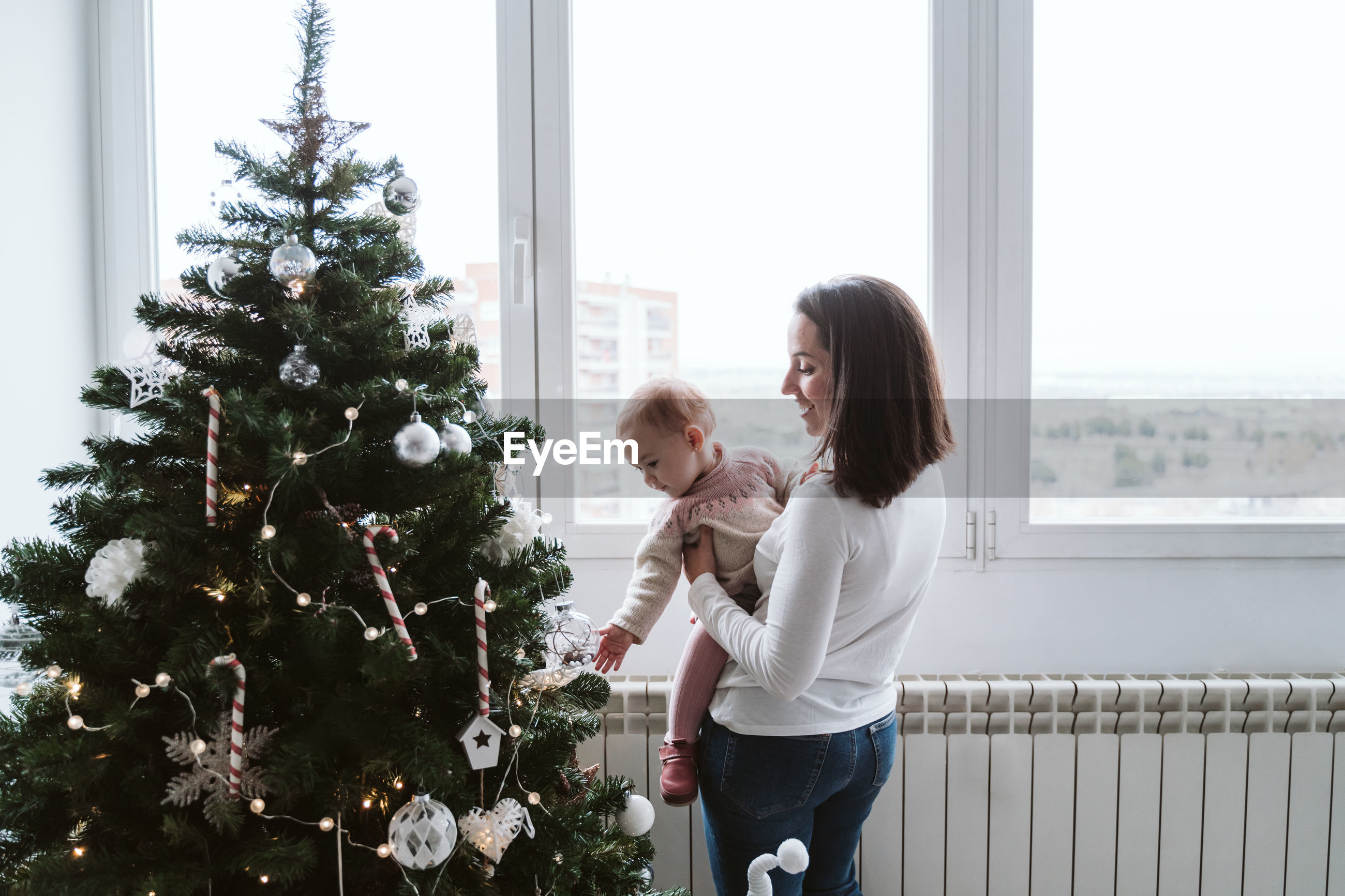 Mother with baby girl at home during christmas