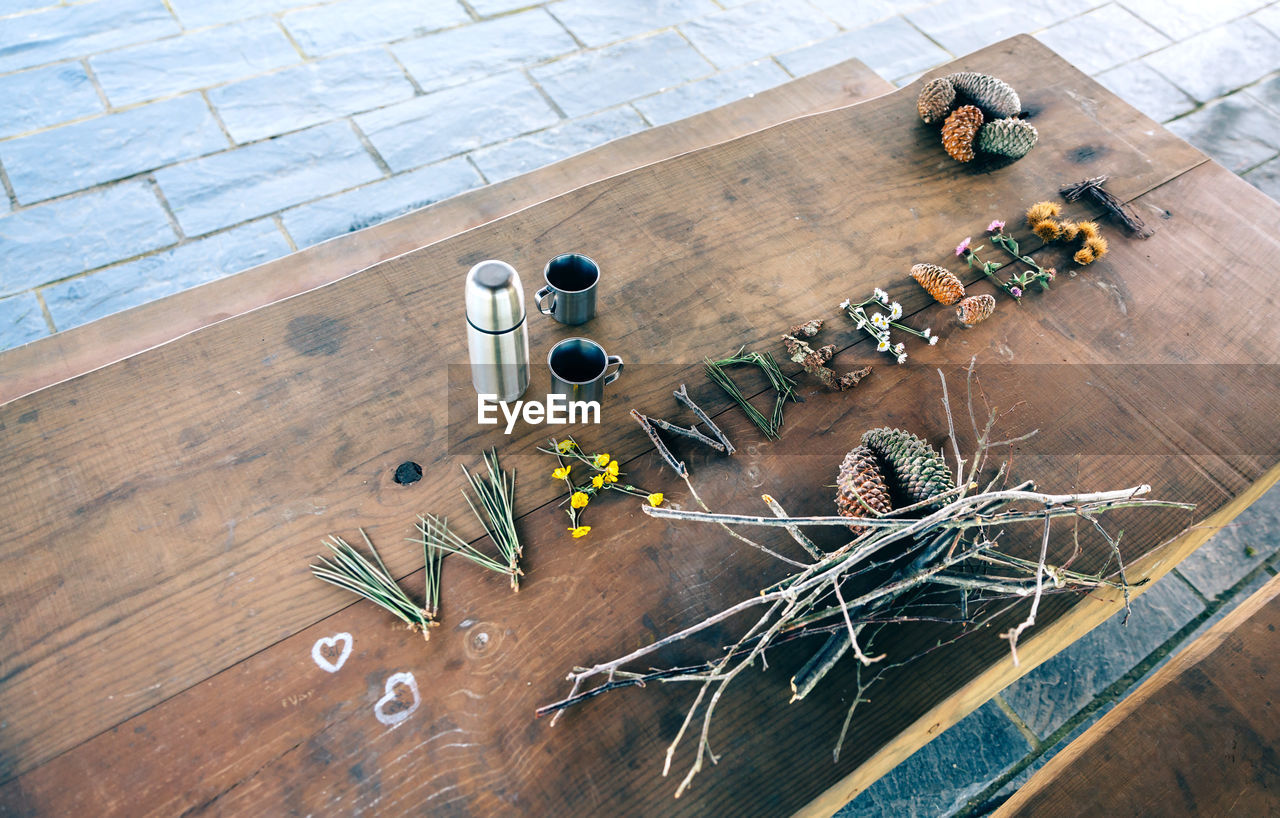 high angle view, table, wood - material, no people, indoors, large group of objects, still life, textile, art and craft, craft, flooring, chair, day, wood, creativity, seat, plant, flower, needle, flowering plant