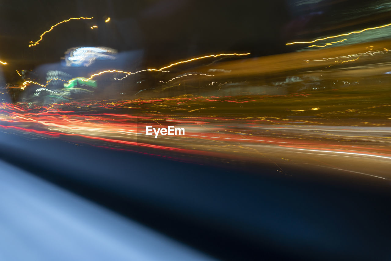long exposure, light trail, motion, night, illuminated, speed, blurred motion, multi colored, no people, transportation, glowing, city, light - natural phenomenon, road, abstract, architecture, nature, sky, outdoors, cloud - sky, light