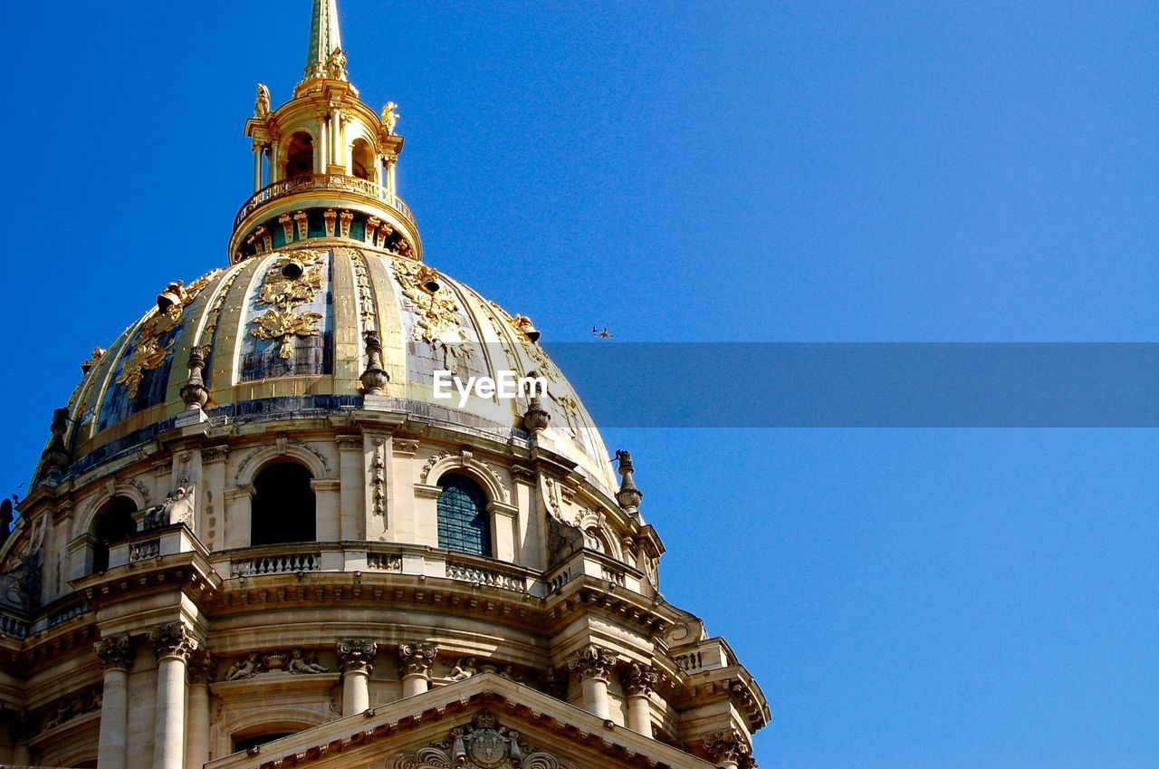 Low Angle View Of Hotel Des Invalides Against Clear Blue Sky
