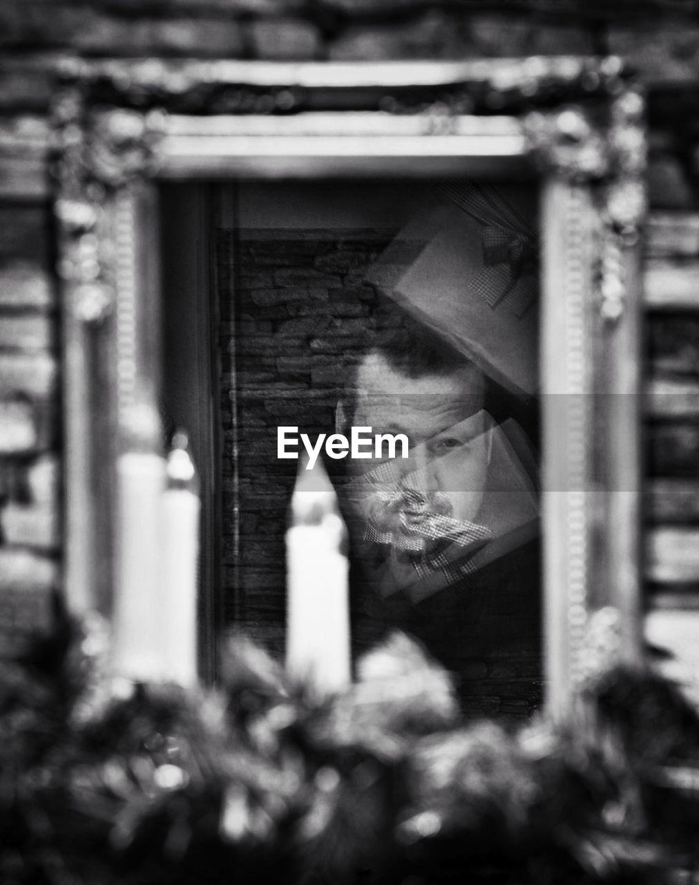 Reflection Of Man Seen On Glass Window