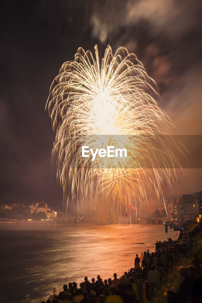 motion, sky, firework, long exposure, illuminated, night, water, firework display, exploding, arts culture and entertainment, event, celebration, nature, blurred motion, cloud - sky, sea, scenics - nature, beauty in nature, land, firework - man made object, outdoors, light, sparks