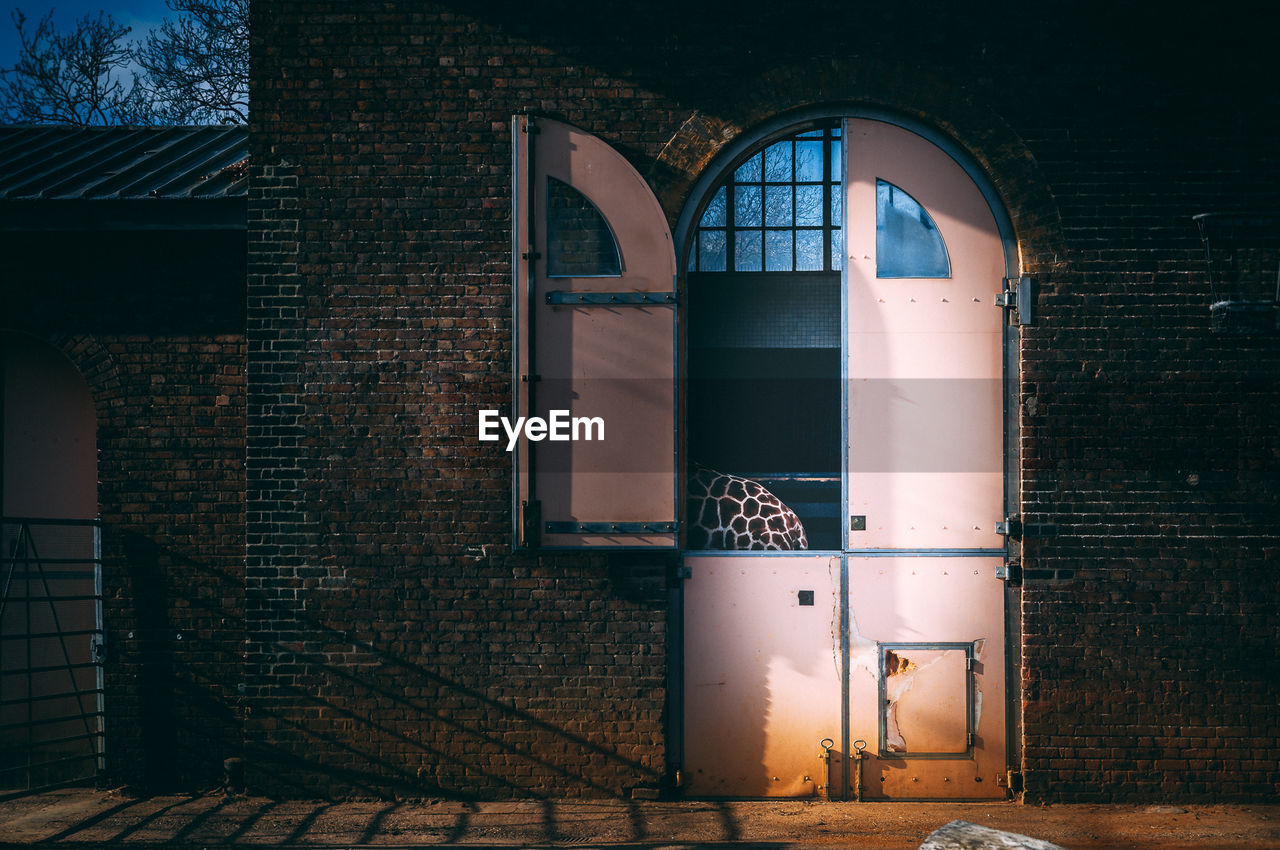 architecture, built structure, building, brick, building exterior, wall, brick wall, wall - building feature, window, entrance, door, no people, arch, house, day, outdoors, closed, lighting equipment, residential district, safety, electric lamp